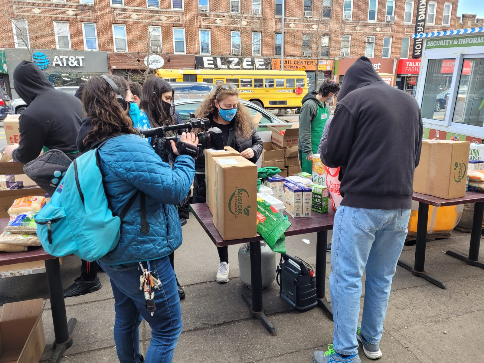 reporter chelsea Kat of NY1 in action during MLK Day 2021 at Masbia of Boro Park and Brooklyn College students helping during the covid-19 pandemic