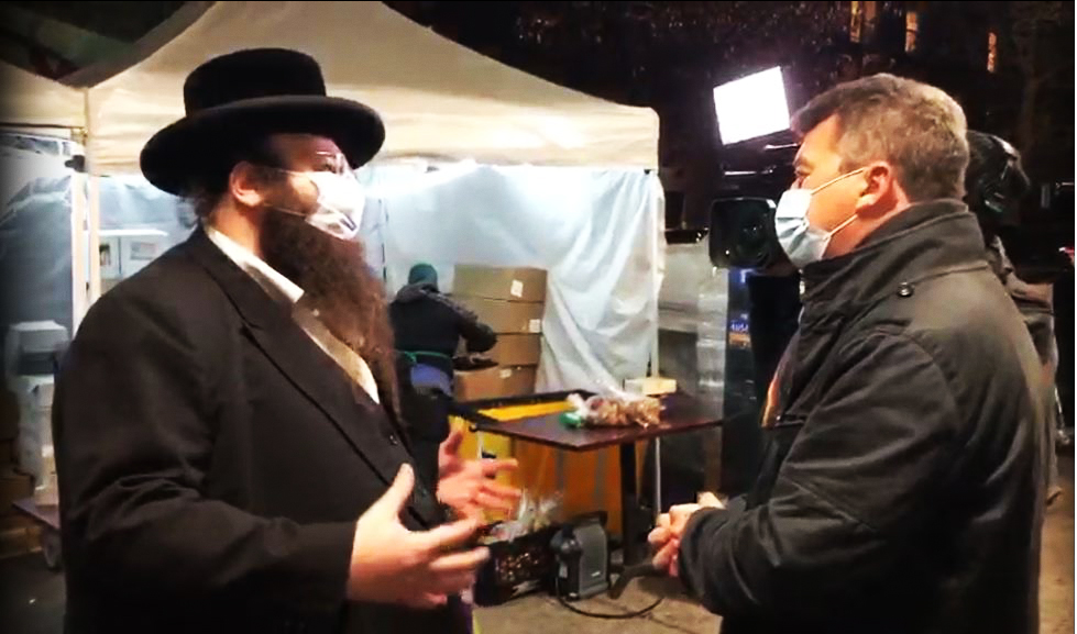 Reporter Nick Bryant of BBC interviews ED Alexander Rapaport of Masbia