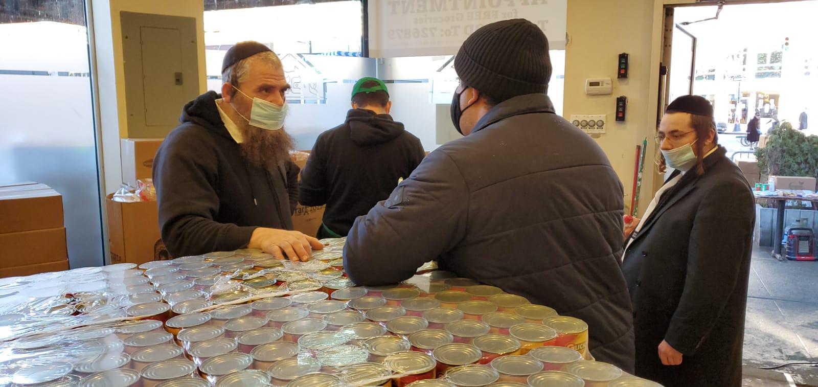 reporter Gabriel Sandoval interviews Shimon Posen at Masbia Boro Park during pandemic