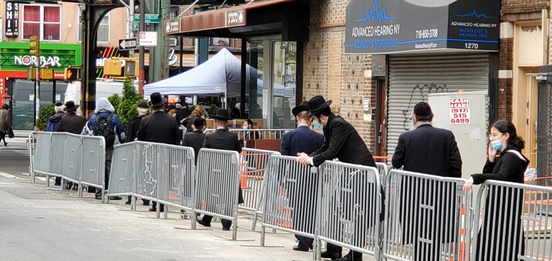 Jewish people in the breadline at Masbia of Boro Park during the pandemic