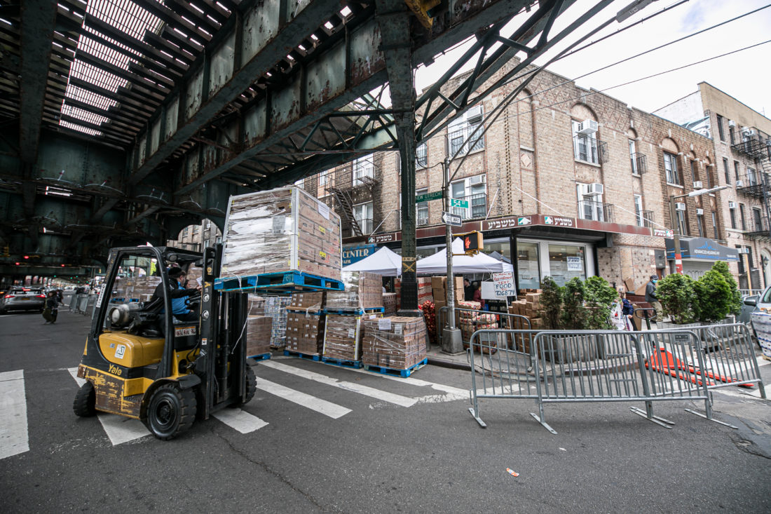 Piling Pallets of food outside Masbia of Boro Park during covid-19