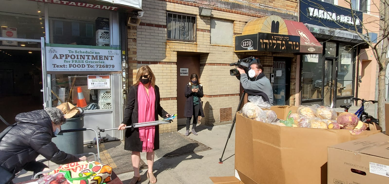 reporter sharon crowley at Masbia of Flatbush interviewing clients during passover