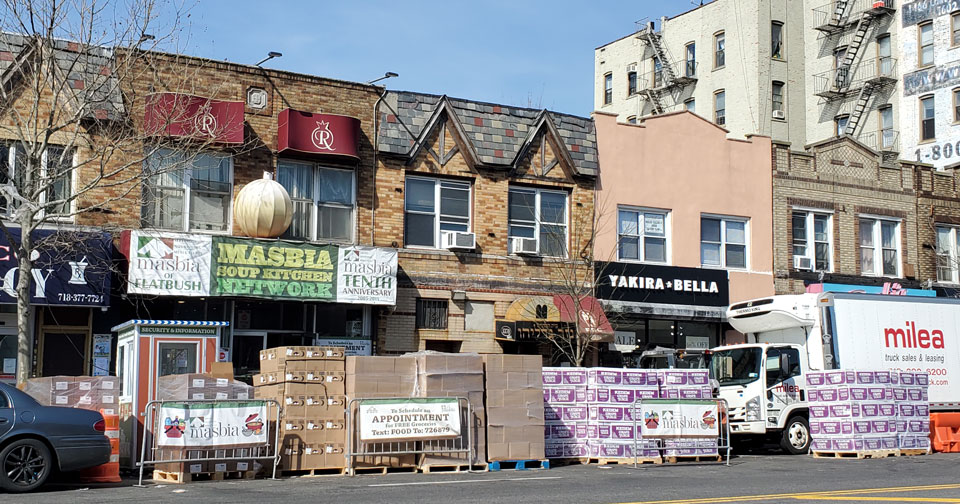 Masbia of Flatbush with a huge supply of Kosher for Passover food outside and refrigerated truck