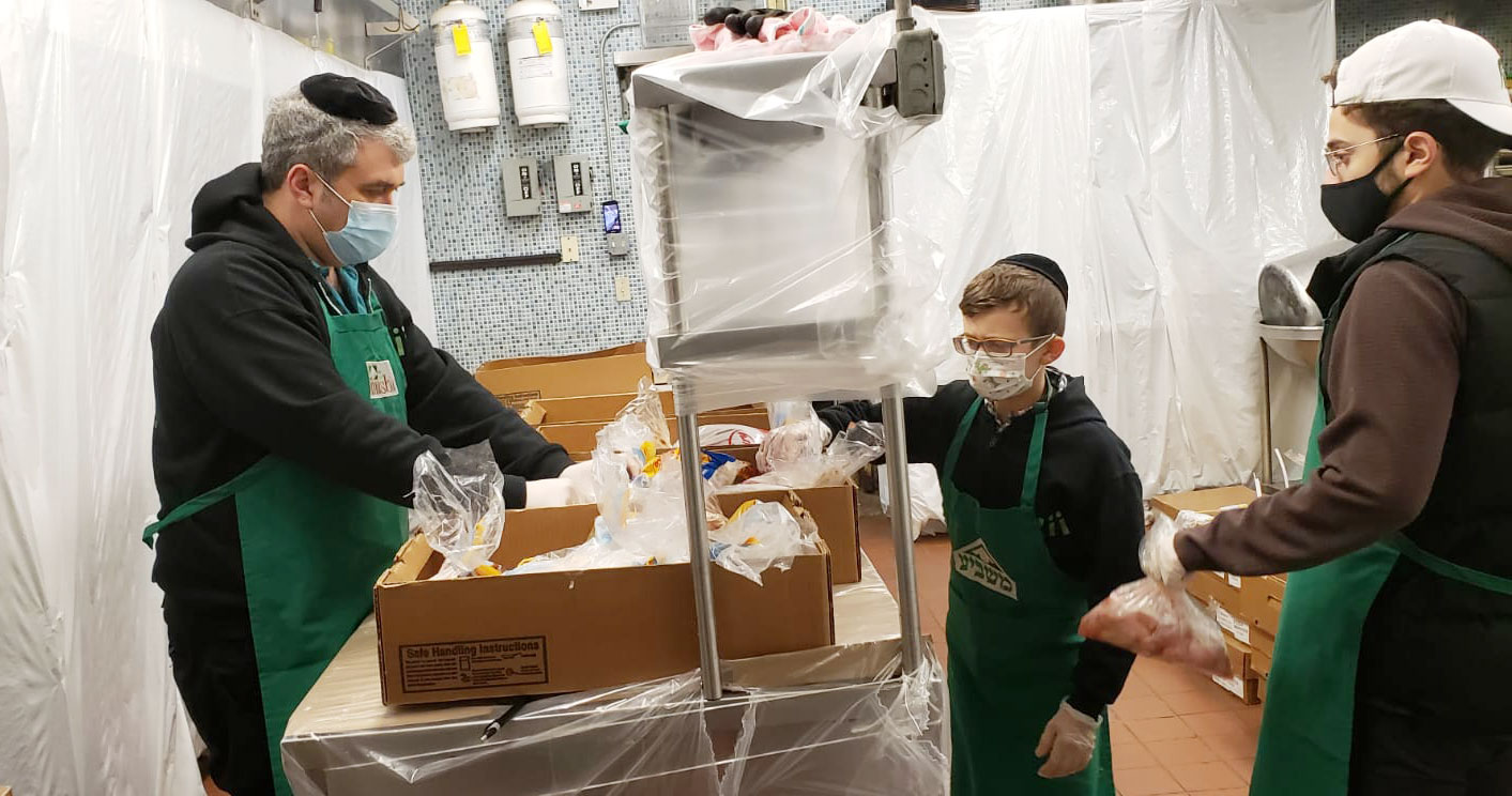 Volunteers Masbia of Flatbush making the Chicken sets for Passover