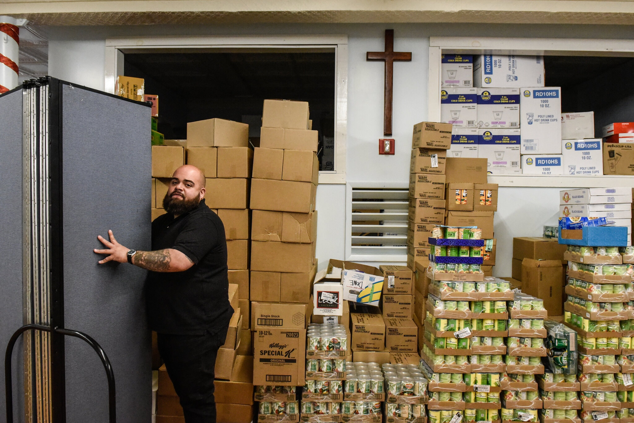 The Rev Mike Lopez ED of the Hungry Monk food operation at his church in Ridgewood Queens