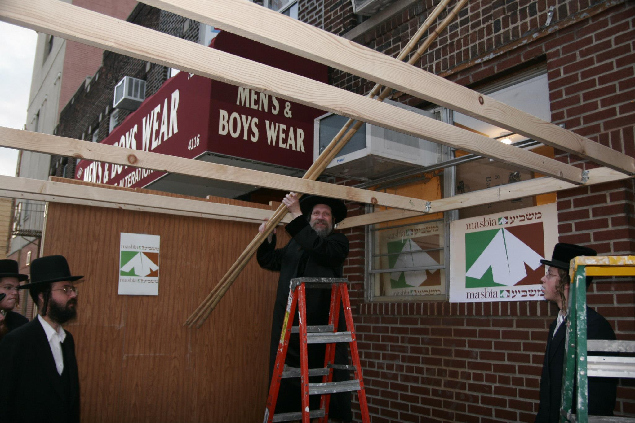 Masbia Supporter, Borshtiner Rebbe, Rabbi David Eichenstein Laying Schach on the Sukkah.jpg