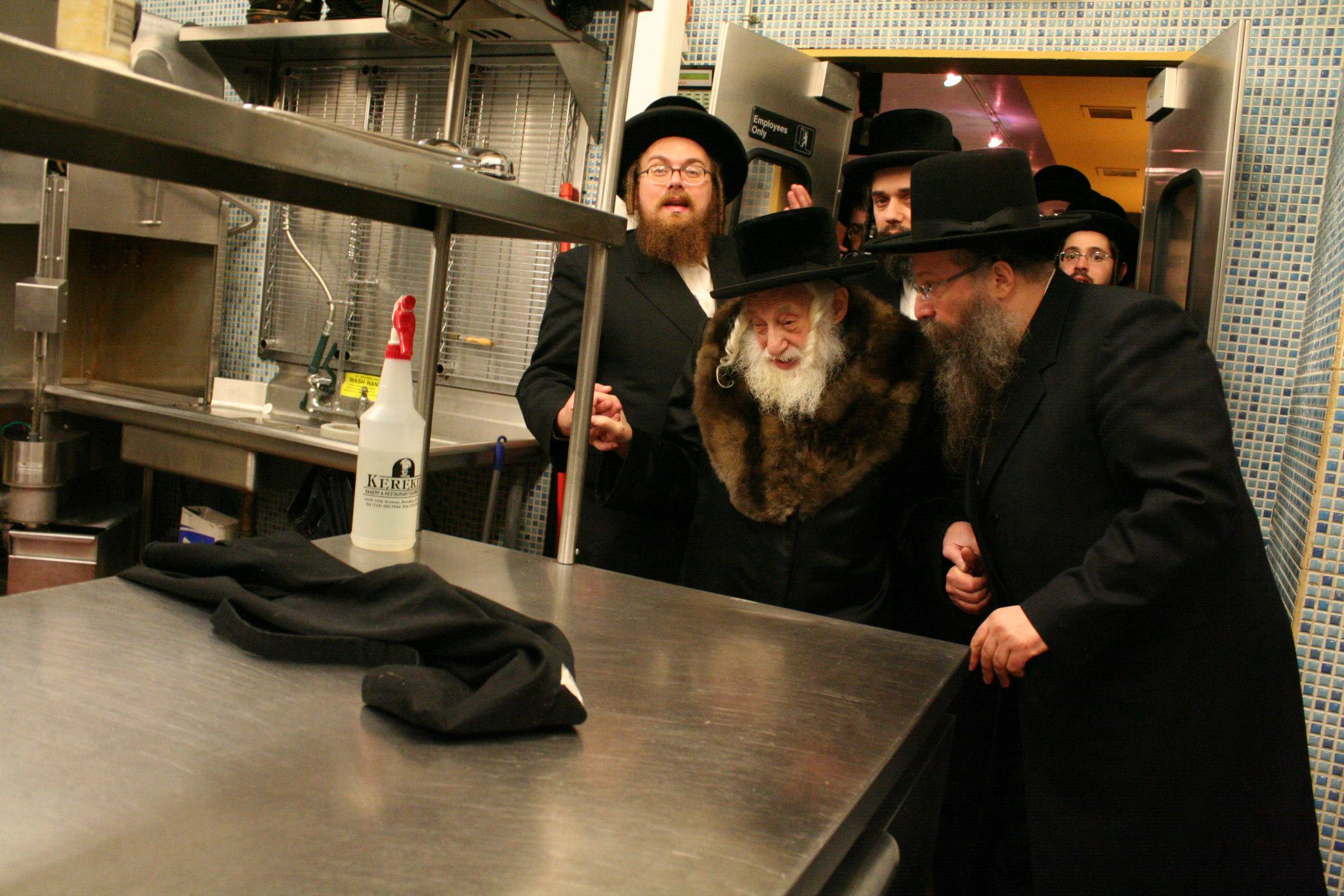 Masbia_Supporter__Skulen_Rebbe__Rabbi_Israel_Abraham_Portugal_Affixing_the_Mezuzah_on_the_Front_Door_of_Masbia_of_Flatbush4.jpg