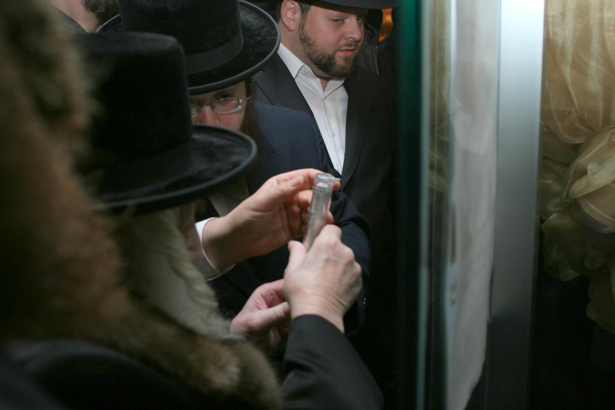 Masbia_Supporter__Skulen_Rebbe__Rabbi_Israel_Abraham_Portugal_Affixing_the_Mezuzah_on_the_Front_Door_of_Masbia_of_Flatbush3.jpg