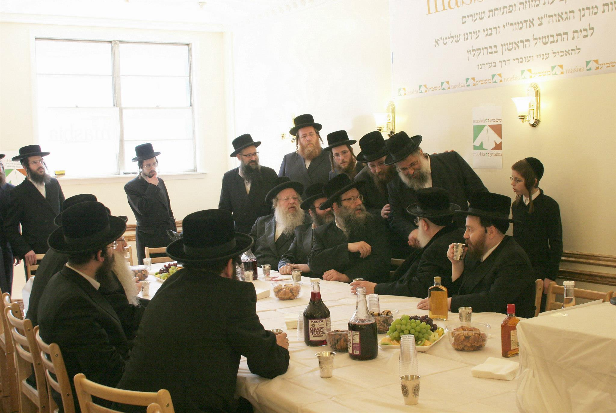 Masbia_Supporter__Rachmastrivka_Rebbe__Rabbi_Chai_Yitzchok_Twersky_Affixing_the_Mezuzah_at_Masbia_of_Boro_Park2.jpg