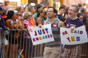 Thom Watson and Jeff Tabaco march with the MEUSA contingent as part of the San Francisco Pride Parade