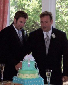 David and Jeff Janis-Kitzmiller cut the wedding cake at their 2008 reception
