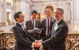 Jeff Tabaco and  Jeff Tabaco and Thom Watson marry at SF City Hall, officiated by Stuart Gaffney and John Lewis. Photo by Funcrunch Photos.