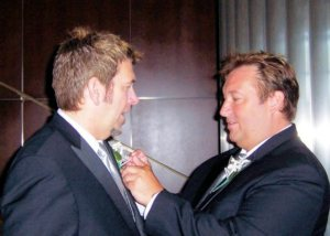 David Janis-Kitzmiller pins a boutonniere on his partner, now husband, Jeff, as they become the first same-sex couple married in Solano County in 2008