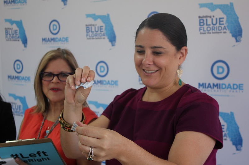 Maggie Fernandez ripping up her old voter reg card