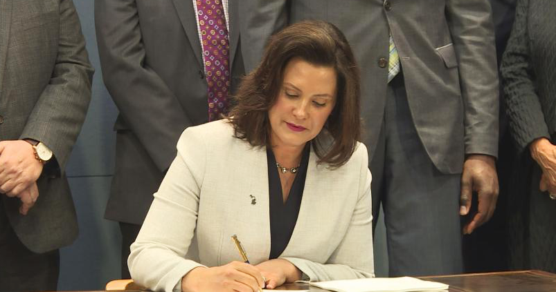 Governor Whitmer signs the recent Executive Order