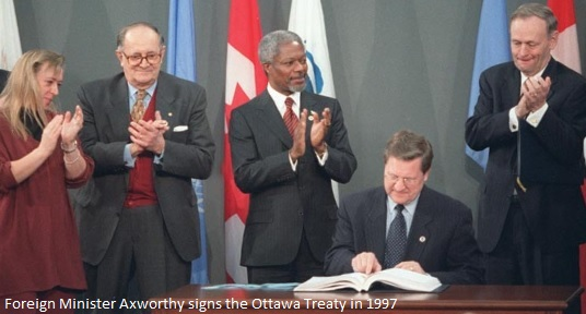 Foreign Minister Axworthy signs the Ottawa Treaty in 1997