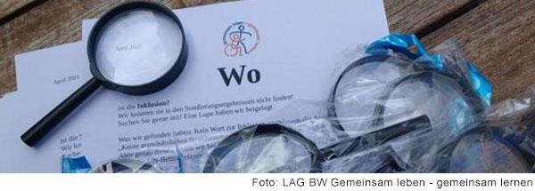 Briefkopf mit dem Logo von Gemeinsam leben– gemeinsam lernen, auf dem groß das Wort Wo steht. Um den Brief herum liegen mehrere Lupen.