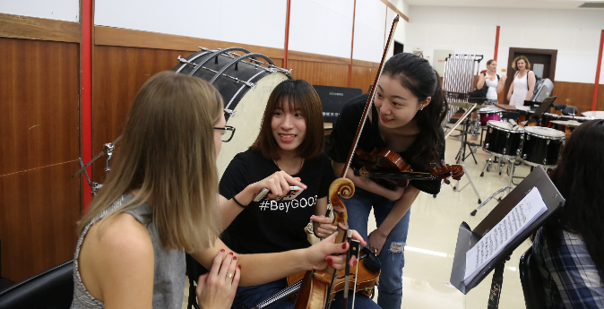 5.png SSO members working with students at the Xinghai Conservatory of Music
