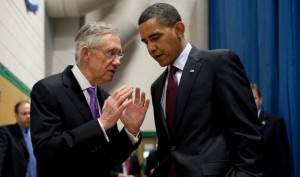 Senate Majority Leader Harry Reid consults with President Obama