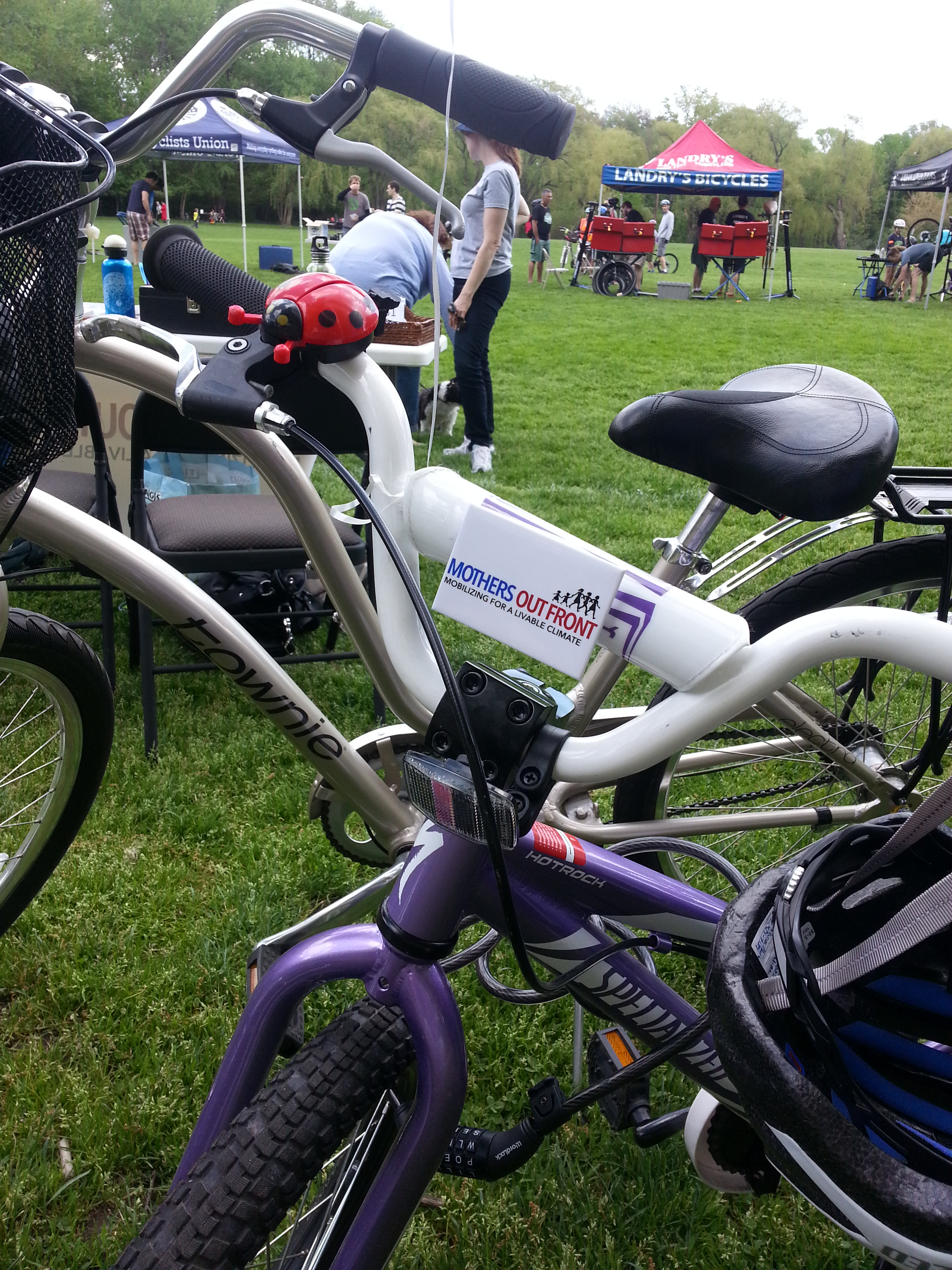 Child's bike with Mothers Out Front pin