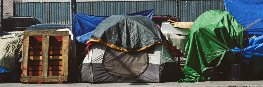 tents-on-sidewalk-fence.jpg