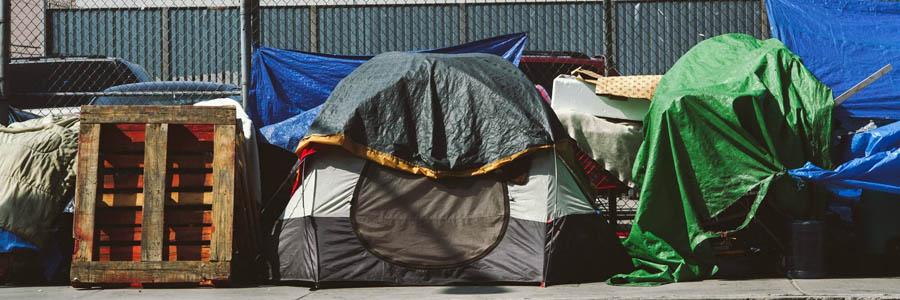 tents-on-sidewalk-fence.jpg