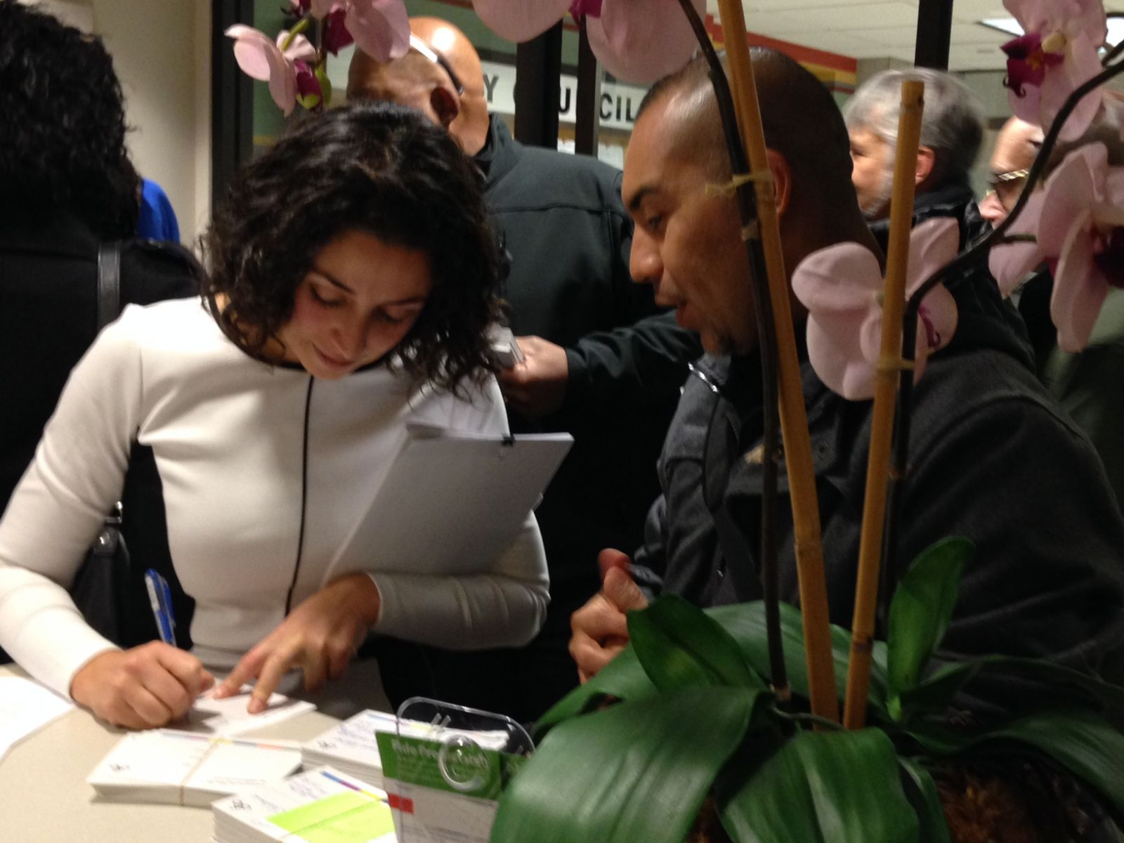 12-2-14_Postcard_Delivery_Event-_CM_Alondra_Cano_signing_post_card_with_William_Martinez.JPG