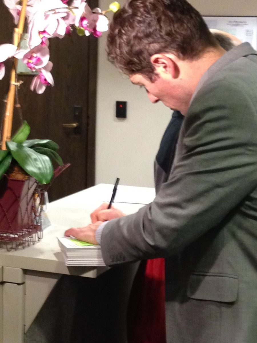 12-2-14_Postcard_Delivery_Event-_CM_Jacob_Frey_signing_postcard.JPG