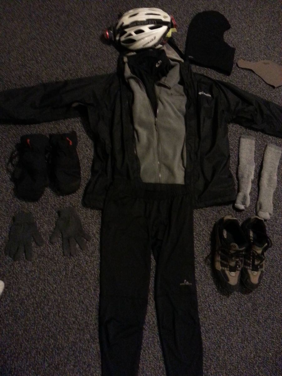 Winter gear laid out in the shape of someone wearing it