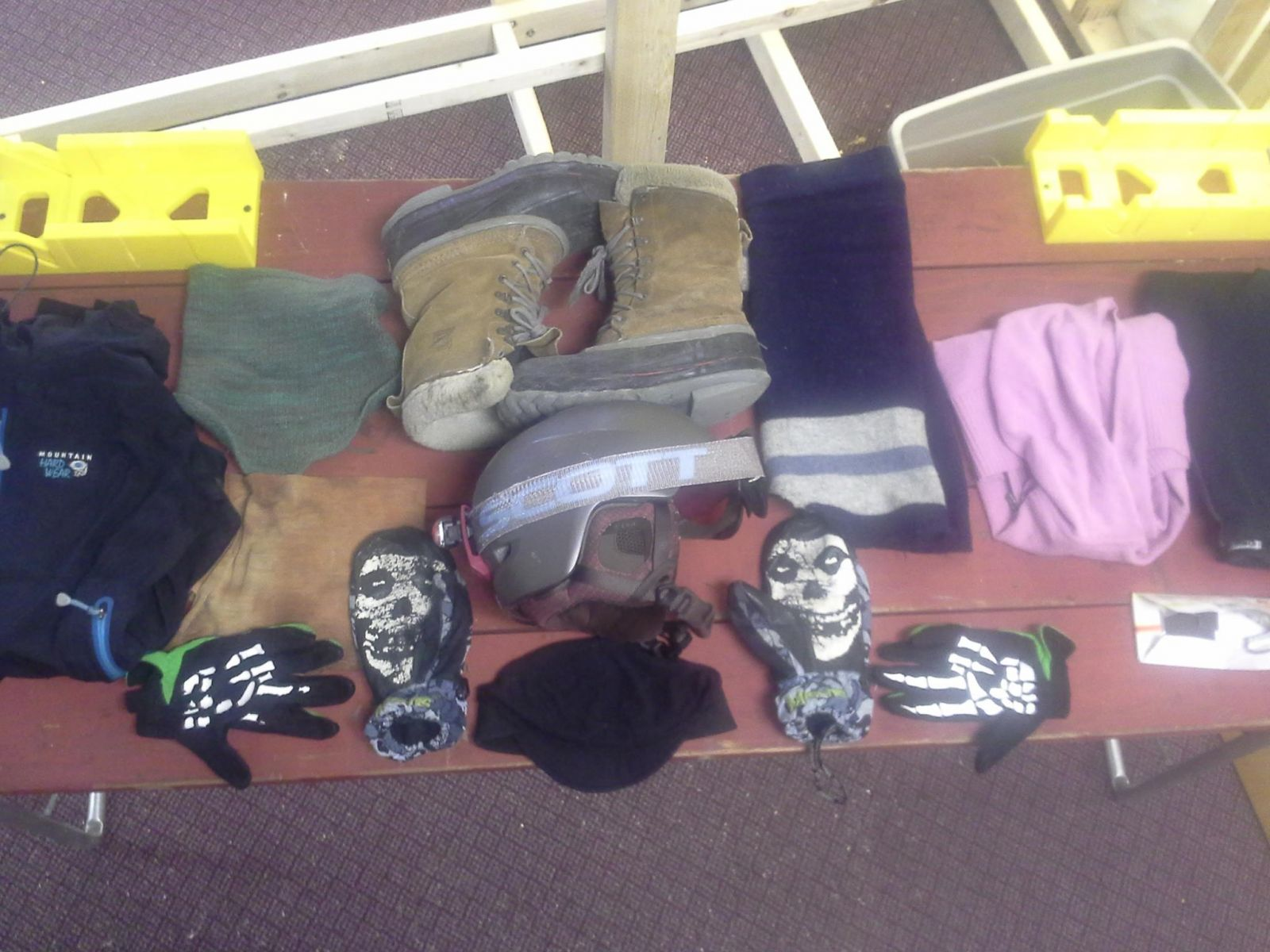 winter gear laid out on a wooden table
