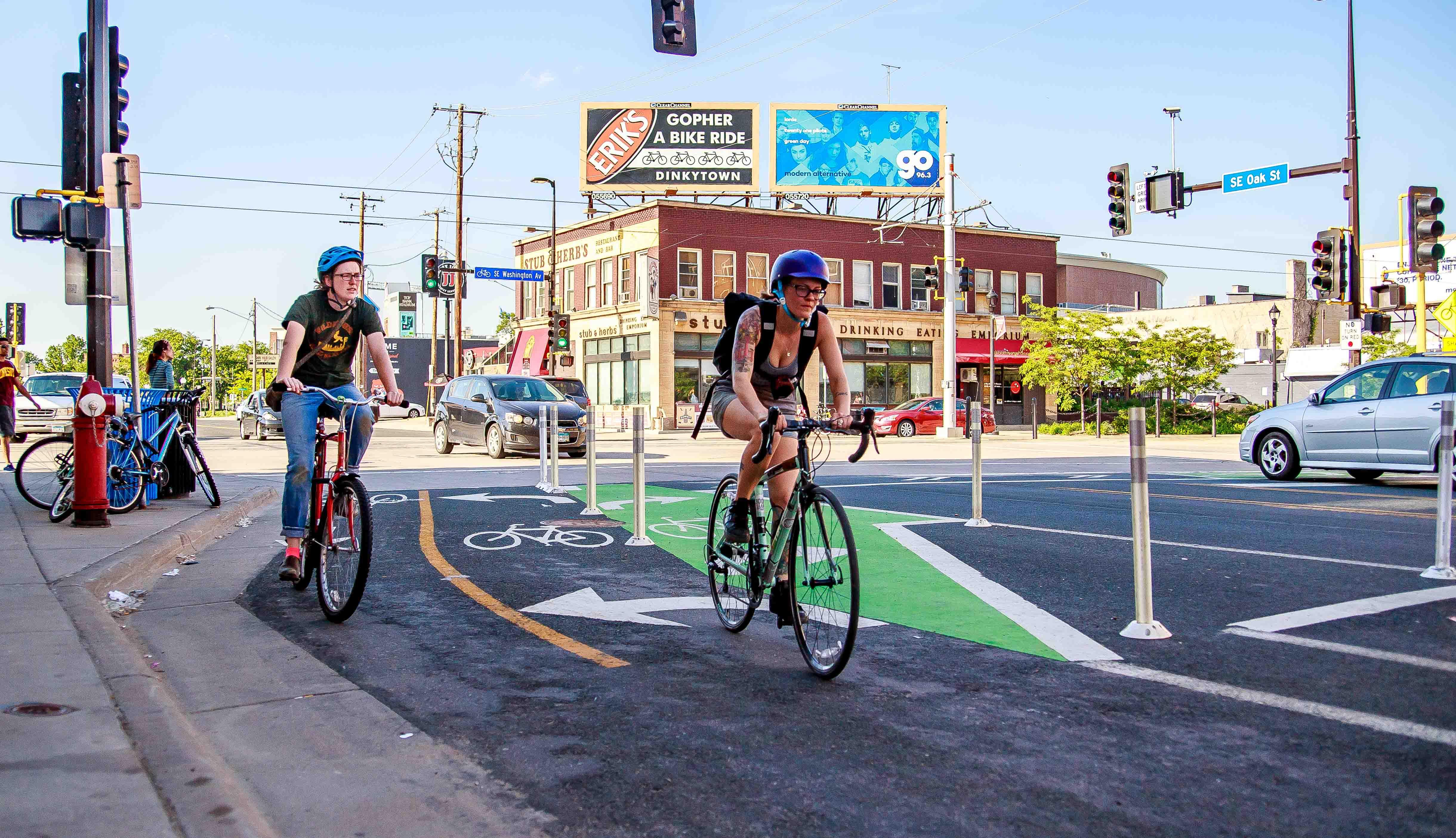 Two people in bike lane