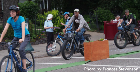 People biking through a pop-up protected bikeway