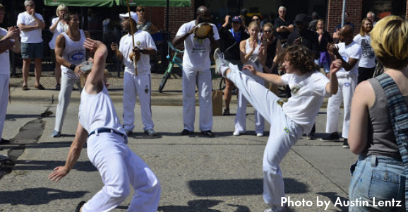 Folks doing capoeira