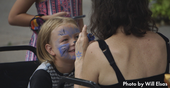 Child having their face painted