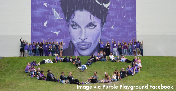 Purple Playground Folks in front of a Prince mural