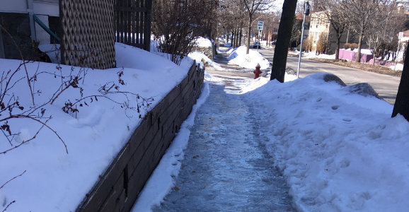 A Minneapolis sidewalk covered in a sheet of ice