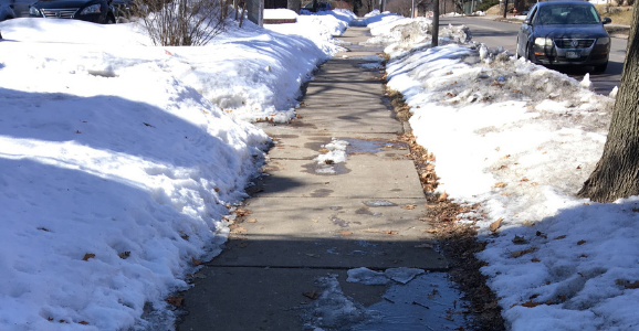 Partially cleared Minneapolis sidewalk in the winter