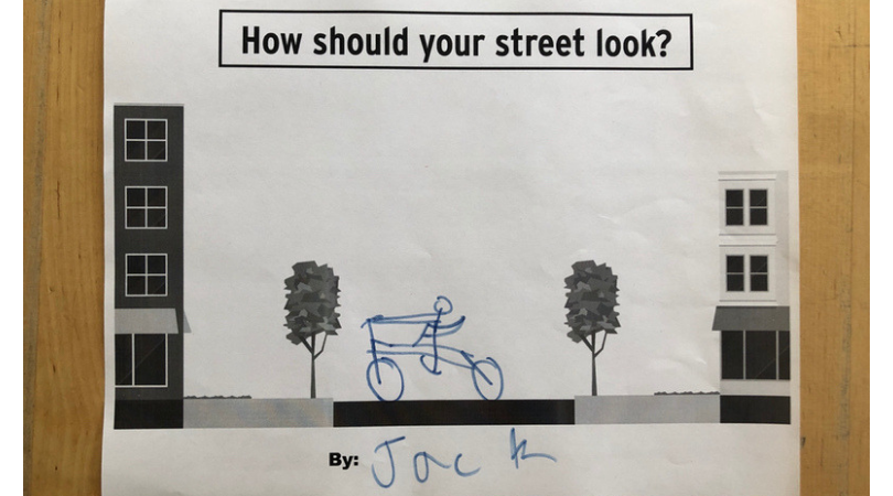 Hand drawn person on a bike in the middle of a streetscape template