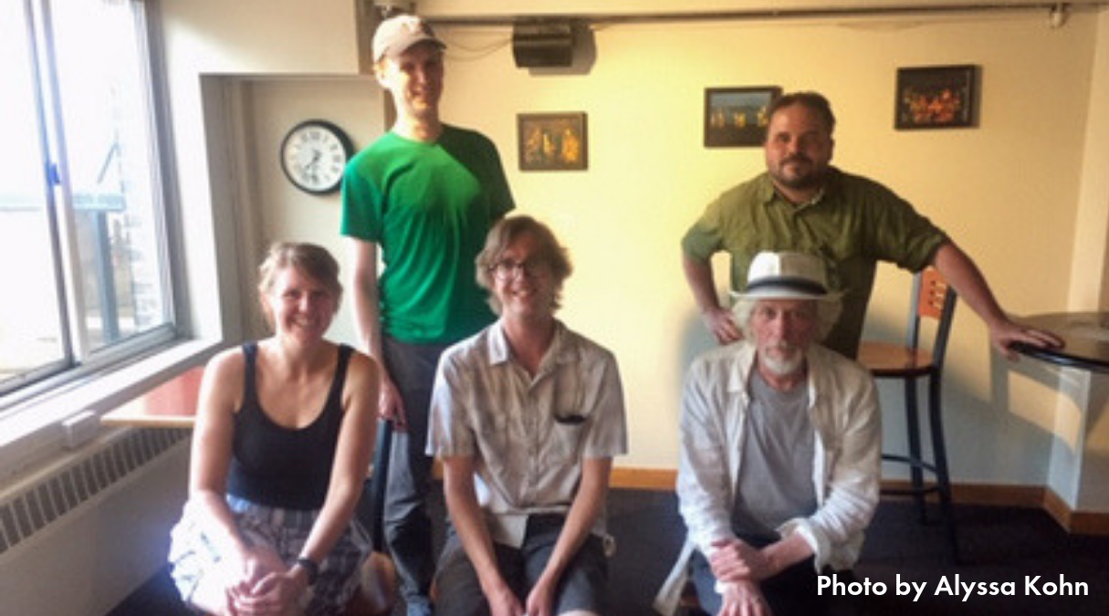 Photo of five members of the Downtown Bikeways Work Group at their June 2019 meeting