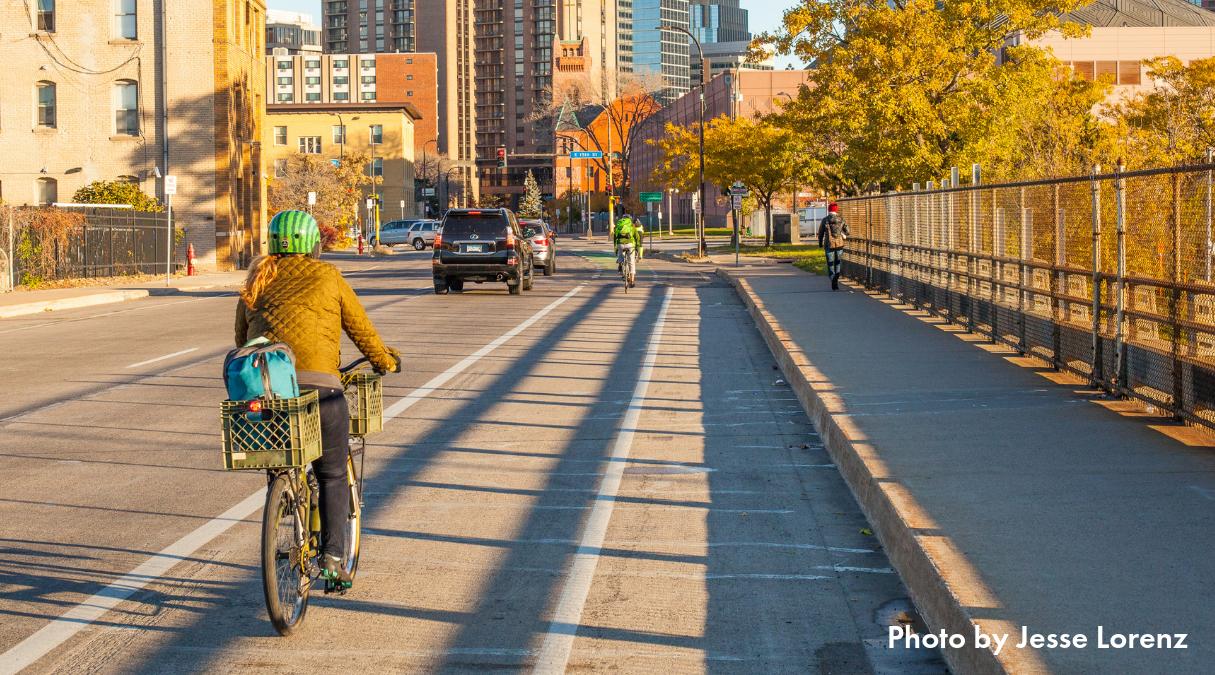 Person biking on an unprotected bike lane downtown Minneapolis