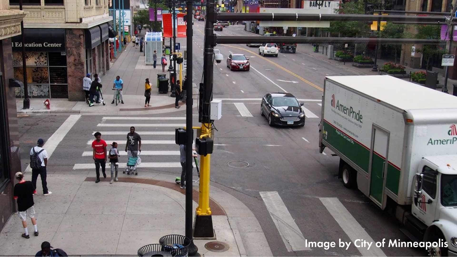 Downtown Minneapolis intersection with folks using many transportation modes