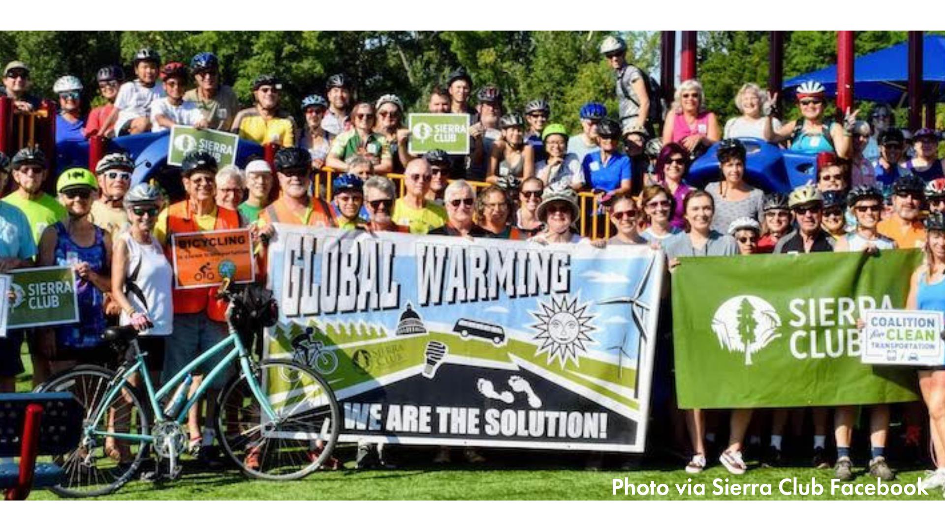 folks gathered behing sierra club banner