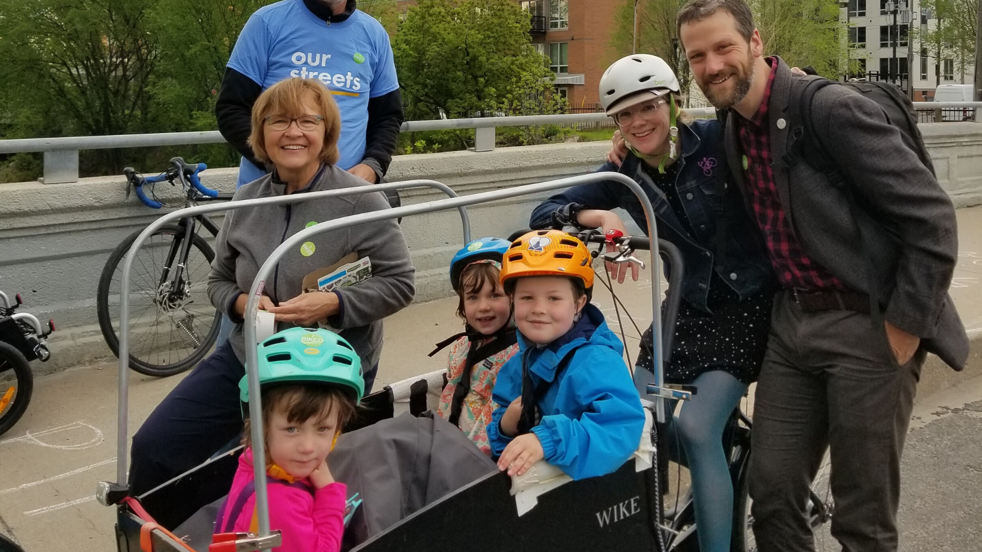 Molly Sullivan biking with her family at Twin Cities Bike to Work Day 2019