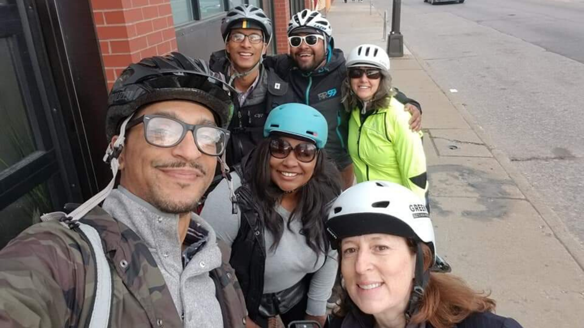 LaTrisha Vetaw, center, poses for a selfie with other folks in bike helmets