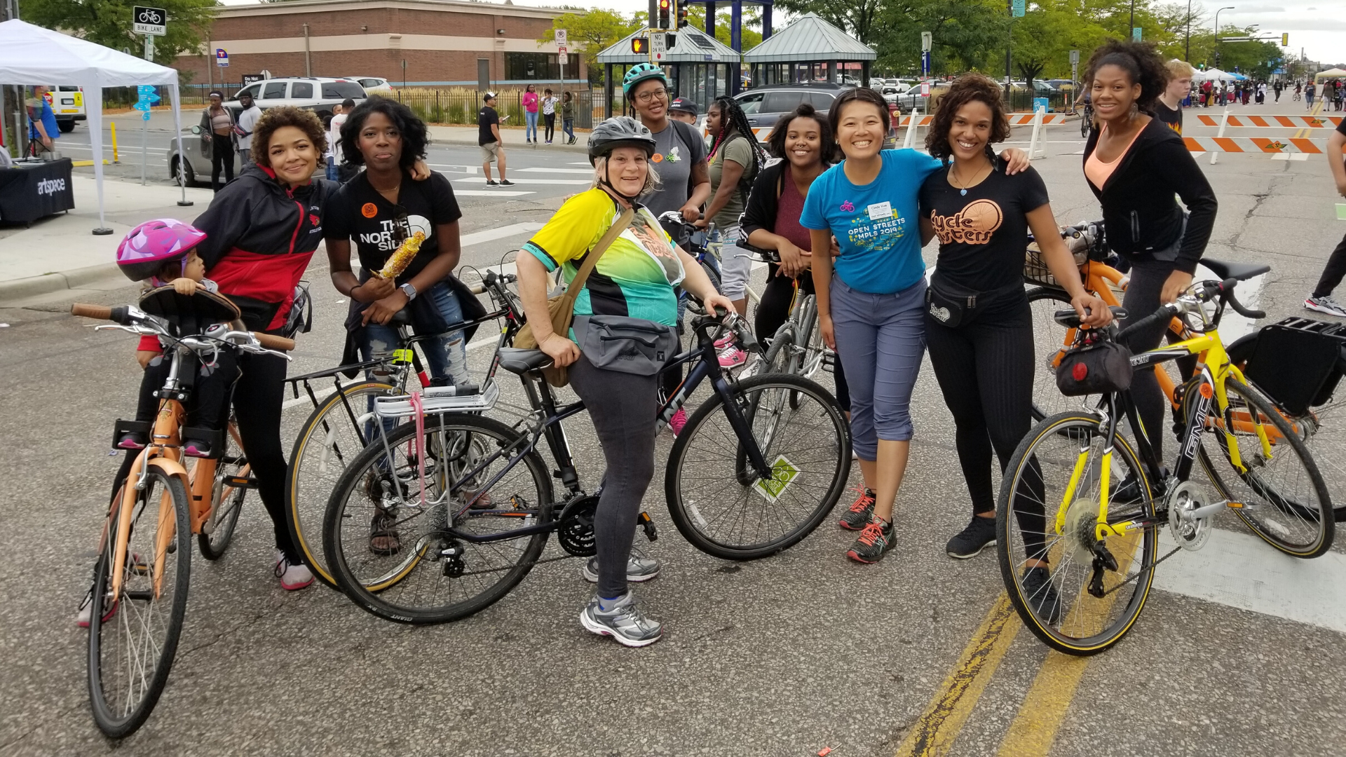 Folks biking with the Cleveland Neighborhood Association Cycle Sisters at Open Streets West Broadway