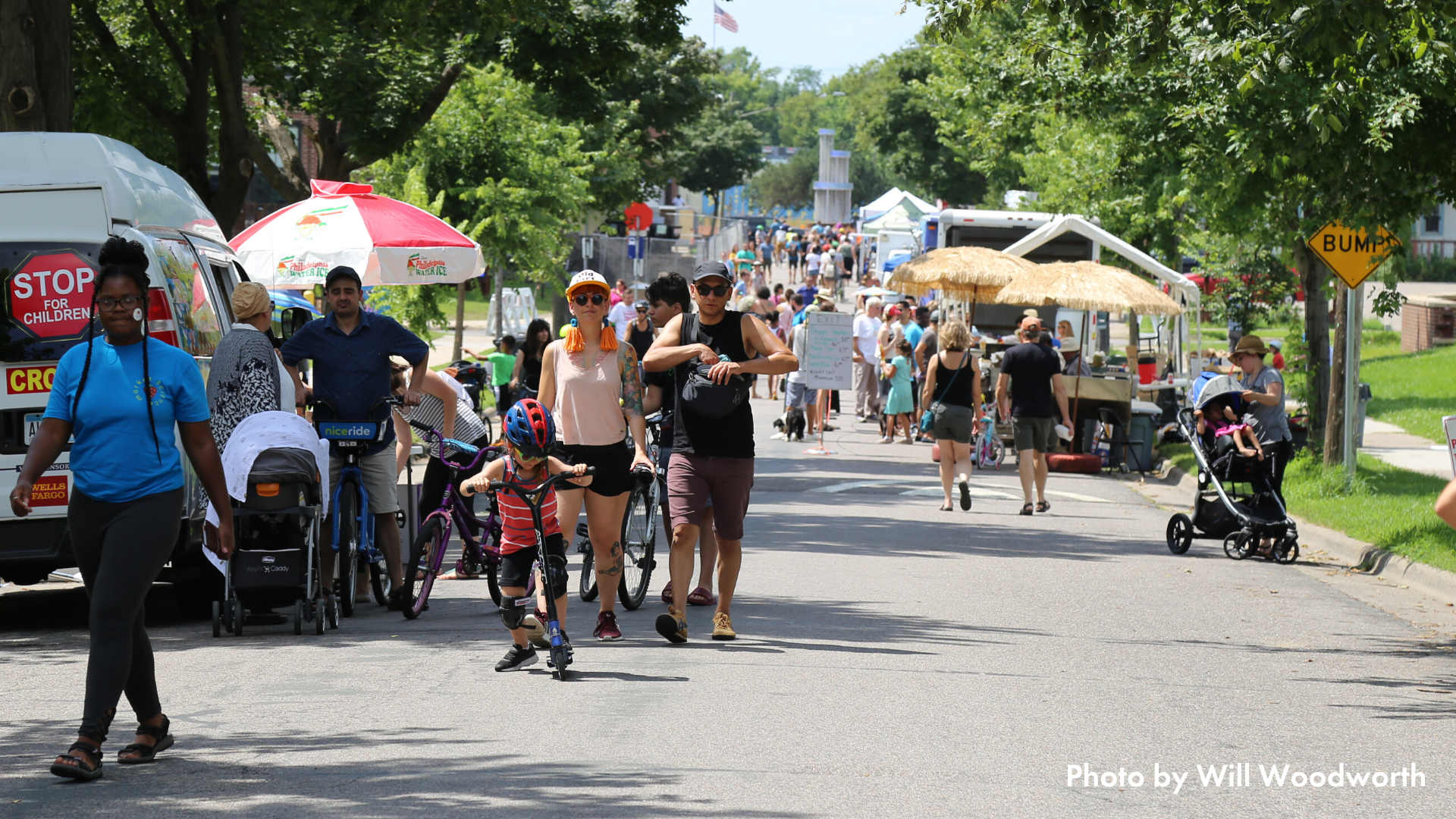 Folks biking, walking, and rolling in the street at Open Streets Northeast