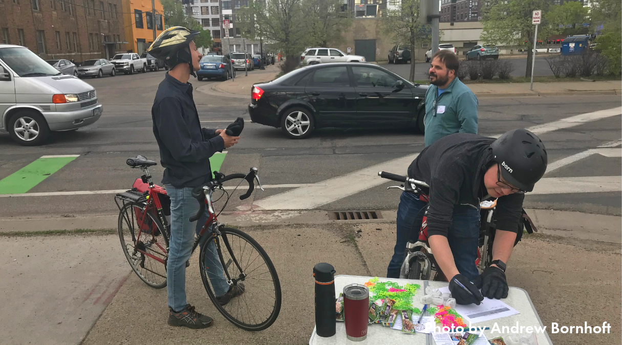 Downtown Bikeways volunteer talking to folks about Downtown/Whittier connection