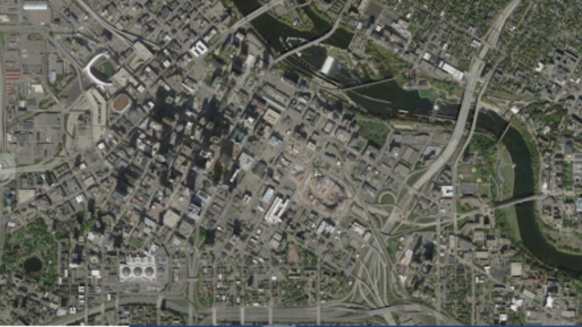 Downtown Minneapolis in 2014 with many highways cutting through the city, lots used for parking