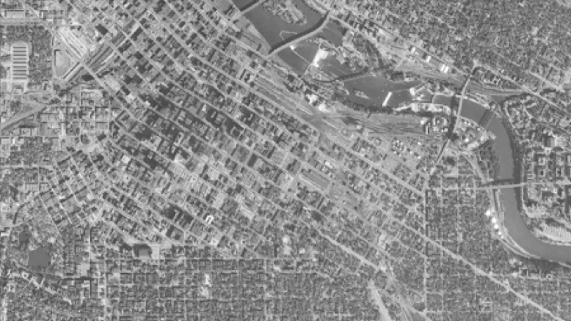 Downtown Minneapolis in 1954 with narrow streets, lots of land used for buildings