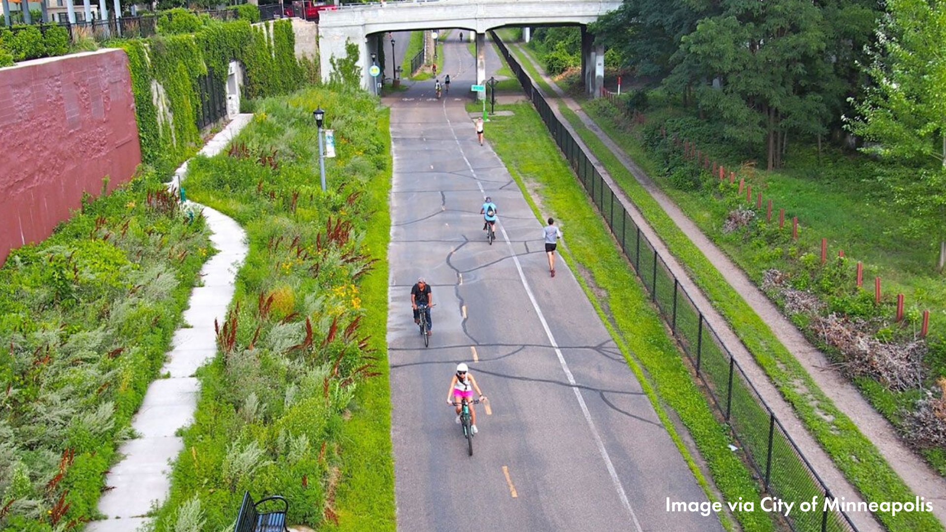 People biking on the midtown greenway as seen from above